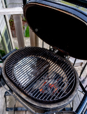 Run the grill at 450F dome temperature with good searing capability over the coals and gentler heat on the indirect side