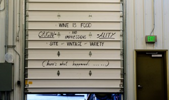 In a corporate setting, this might be viewed as a mission statement. Here, it's handwritten on the inside the big access door in the winery.